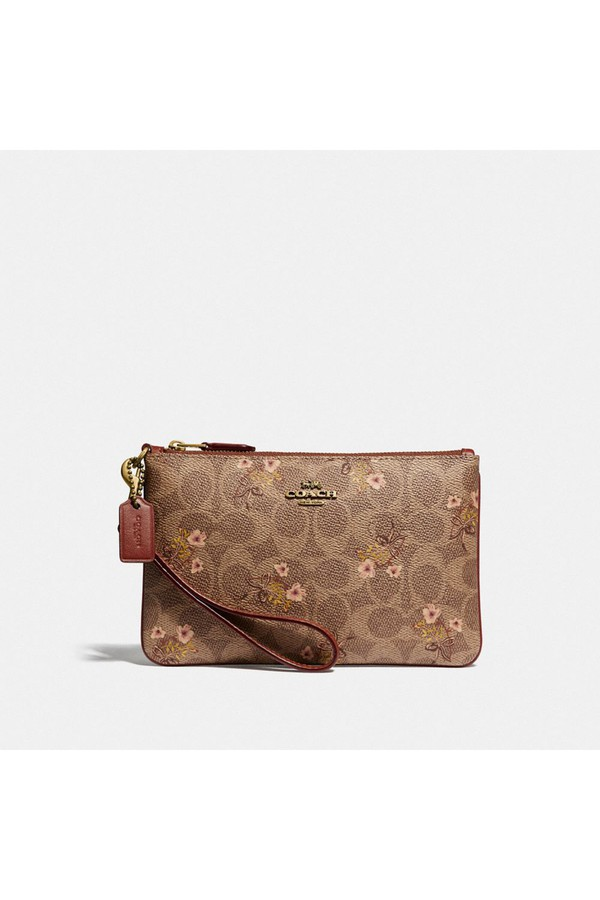 1cdf31437822a7 Small Wristlet In Signature Canvas With Floral Bow Print by Coach...