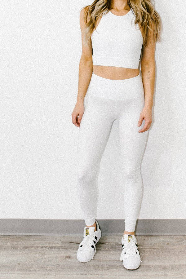 The Gaines Tight is a high waisted basic with a chic mesh trim along the back of the leg for elevated style. The extra wide waistband makes this full length legging comfortable for a stretch class or day off.