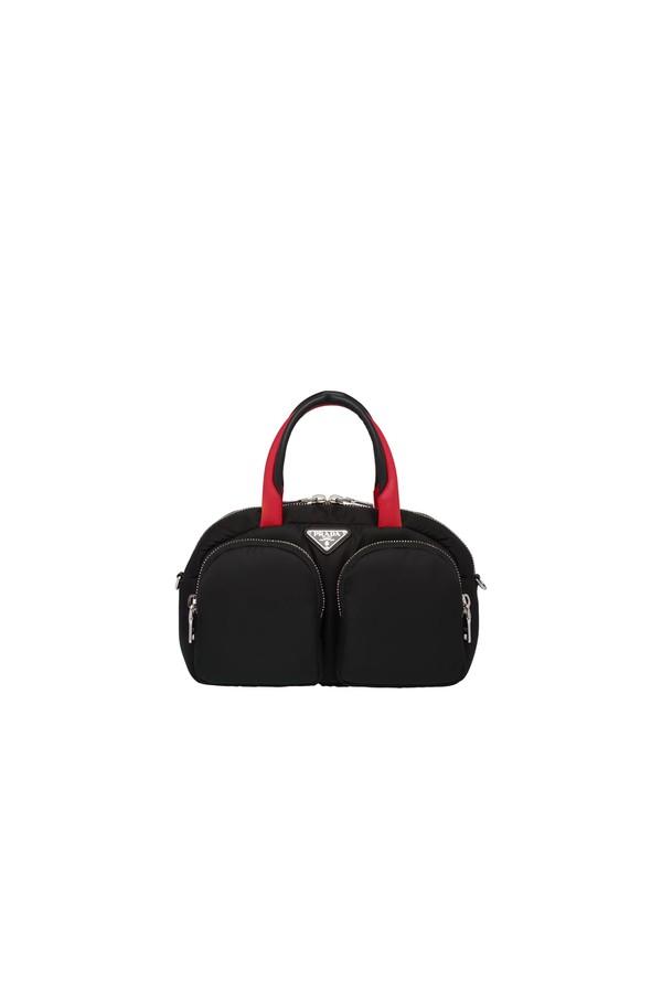 33758ca99586 Padded Nylon Top-Handle Bag by Prada at ORCHARD MILE