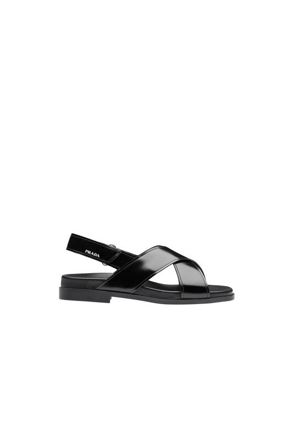 0da42fc7054 Flat Brushed Leather Sandals by Prada at ORCHARD MILE